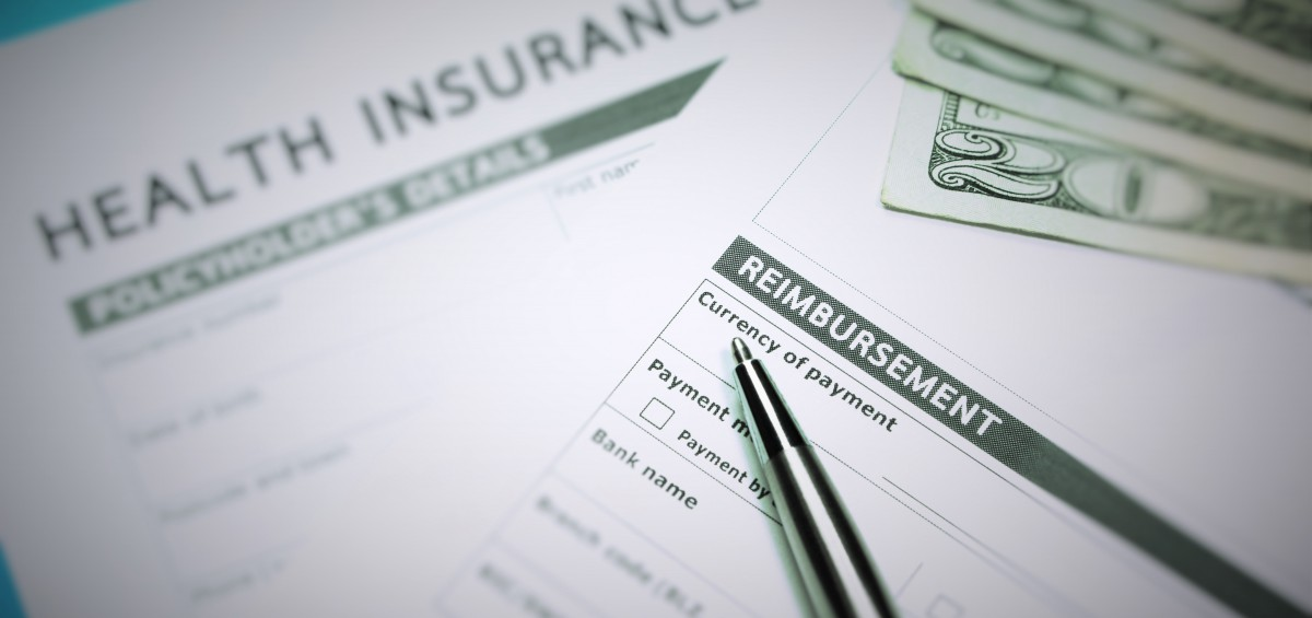 Health insurance claim form with money for insurance concept